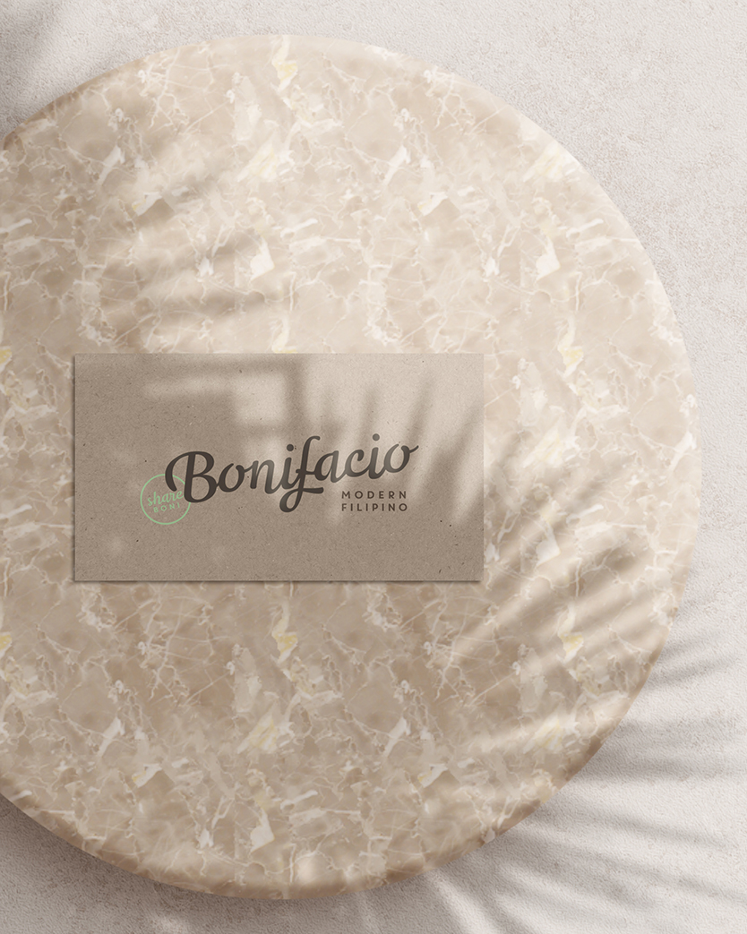 Bonifacio restaurant business card on a marble platter
