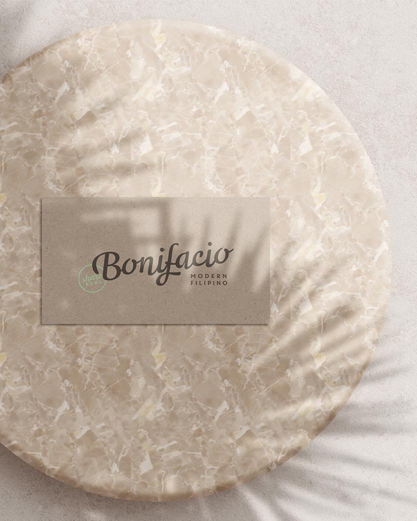Bonifacio restaurant business card on a marble platter